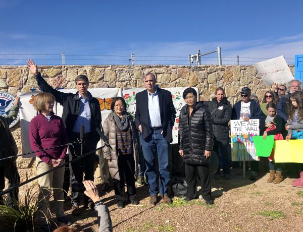Lawmakers from California, Hawaii, Minnesota, Oregon, and Texas gather outside the Tornillo encampment.