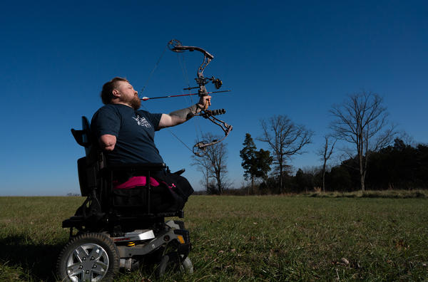 Former Staff Sgt. J.D. Williams practices shooting with his bow in his backyard on Dec. 11, 2018. Williams uses his love of hunting not only as therapy for himself but for other disabled combat veterans.