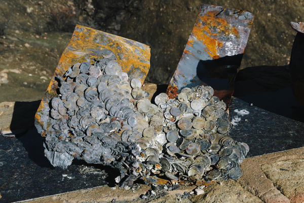 Coins melted together on Jones' property. He had a pot of coins for his grandchildren to pull from when they visited.