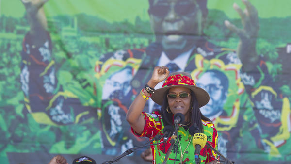 Grace Mugabe, then Zimbabwe's first lady, greets supporters at a rally last year in the city of Lupane. South African police now want to see her arrested for allegedly assaulting her son's girlfriend.