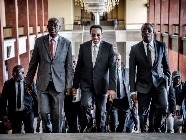 Bruno Tshibala (center), the prime minister of the Democratic Republic of the Congo, arrives for a meeting Thursday with the country's electoral commission president about postponing the presidential election.