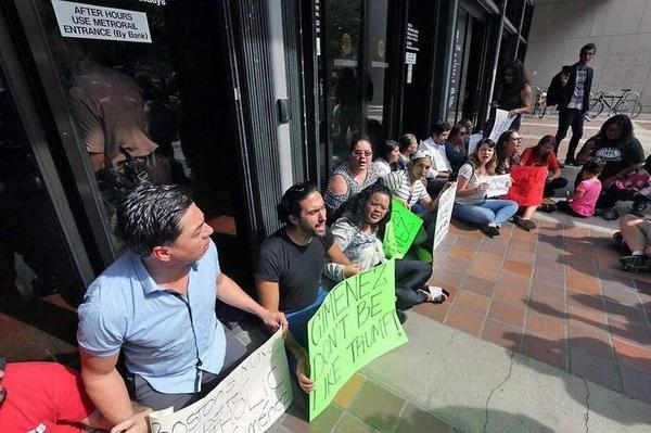 Protesters block the entrance to Miami-Dade County Hall following the January 2017 decision from Mayor Carlos Gimenez to start honoring ICE detainer requests.