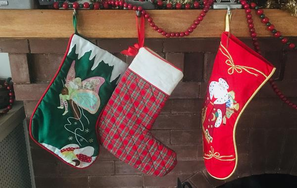 """Carla Padvoiskis' father died unexpectedly when she was 18. His death readjusted how she, her sister and her mom decided to spend future Christmases and with whom — with the exception of one constant. """"We always still hang my dad's plaid stocking at Christmas. It feels good to remember him and have his presence there,"""" she says."""