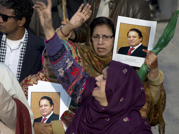 Supporters of former Pakistani Prime Minister Nawaz Sharif shout slogans against the government outside an accountability court in Islamabad, where Sharif was sentenced Monday to seven years in prison.