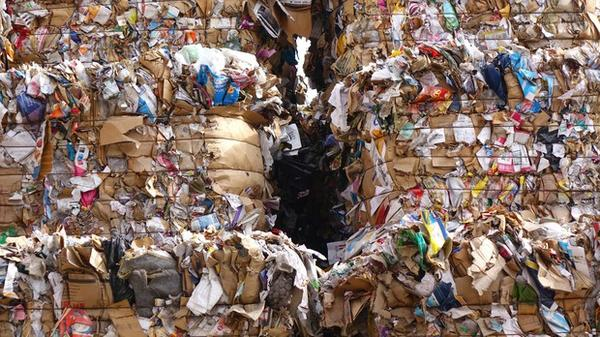 <p>Bales of recycling get wet outside Rogue Waste Systems in White City, Ore.</p>
