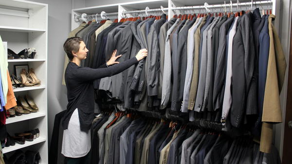 Erin Wolfram at the University of Kansas Career Center with a closet full of interview suits made available to students.