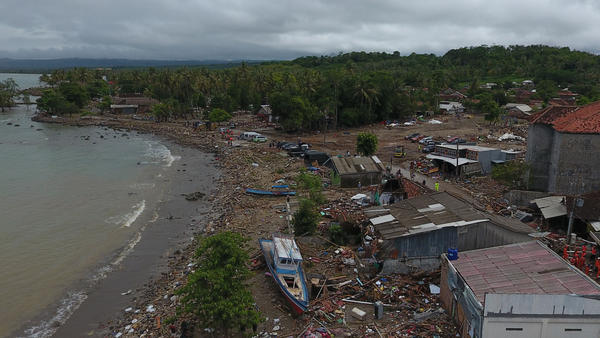 Damaged houses, boats and debris are seen after a tsunami in this aerial photo taken in Sumur, Pandeglang, Banten province, Indonesia, on Tuesday. The death toll from a tsunami now exceeds 400.
