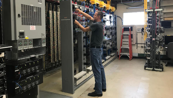 A technichian with Shawnee Communications in Lovington, Illinois, surveys the company's fiber internet connection.
