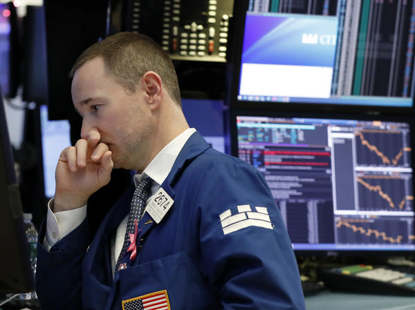Specialist Stephen Naughton works on the floor of the New York Stock Exchange on Thursday.