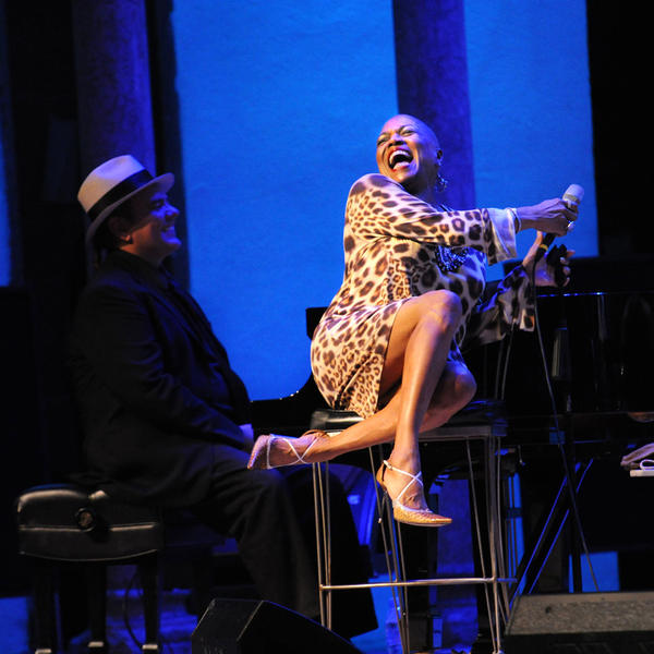 Dee Dee Bridgewater (right) smiles big with pianist Edsel Gomez in a 2014 performance at the Caramoor Jazz Festival.