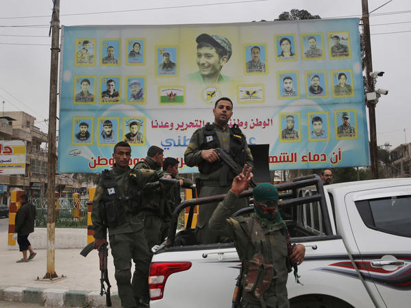 U.S.-backed Kurdish militants seem to be in talks with the Syrian regime to hand over the city of Manbij. Turkey has threatened an offensive against the town if the Kurds remain in control. Here, members of the Kurdish internal security force are seen in a photo from March.