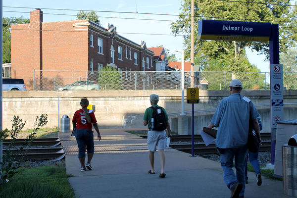 Volunteers look for people experiencing homelessness at the Delmar Loop Metro stop in July 2016 during St. Louis County's summer Point-in-Time count.