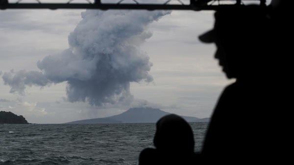 Indonesian Navy personnel watch as Anak Krakatau spews volcanic materials into the waters of Indonesia's Sunda Strait this week.