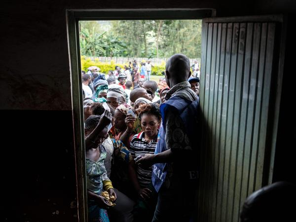 Voters wait to cast their ballot outside a polling station in Democratic Republic of Congo on Sunday.