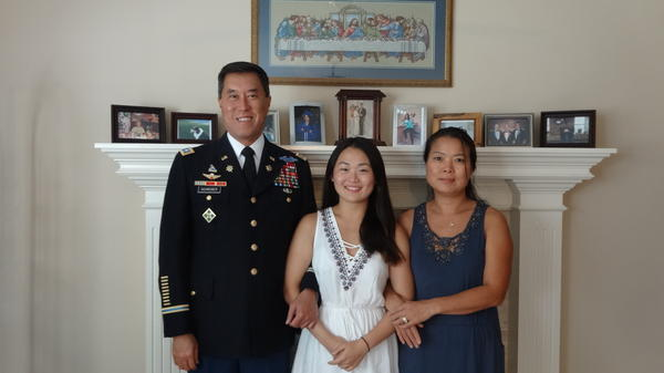 Lt. Col. Patrick Schreiber and Soo Jin Schreiber brought their niece Hyebin, center, to the U.S. from South Korea when she was 15, and adopted her at 17. Federal officials argue she's not eligible for citizenship.