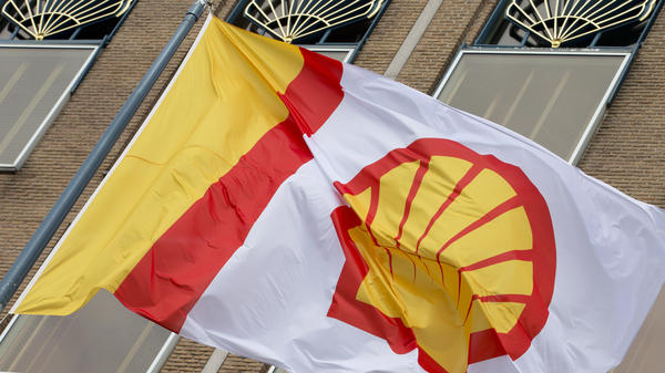 A flag bearing the company logo of Royal Dutch Shell flies outside the energy giant's head office in The Hague, Netherlands, in 2014.