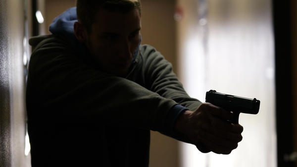 A student participates in a civilian active shooter response course for concealed weapons permit holders on March 24 in Longmont, Colo.