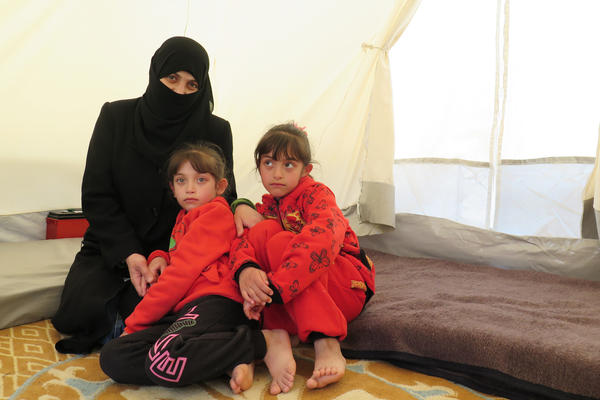 Amani and her twin daughters Masa and Malaz at a camp for displaced persons in northern Syria after fleeing Douma, a town near Damascus, where they say they suffered a chlorine attack.