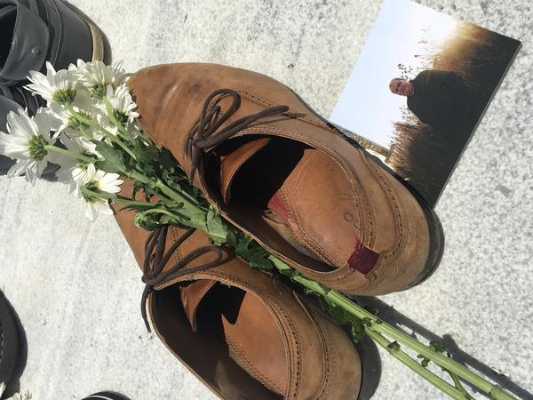 Luis Vázquez placed his shoes at the memorial in remembrance of his father, Luis Manuel Vázquez, who was found dead in his home two weeks after Hurricane Maria.