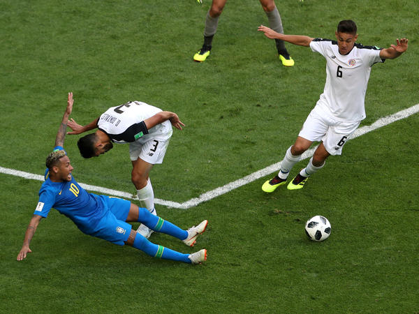 In a June 22 World Cup Match in St. Petersburg, Russia, Costa Rica's Giancarlo Gonzalez fouls Brazil's Neymar (in blue at left), but the penalty was rescinded after Video Assistant Referee review. Brazil went on to win 2-0.