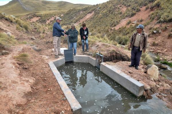 Villagers in Canchayllo stand by a reconstructed canal.