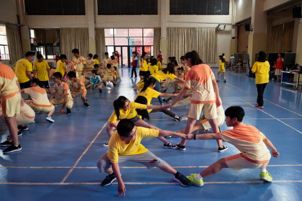 Ethnic Chinese students from the United States and Indonesia join local students for a martial arts class in Taishan, a city in China's Guangdong province.
