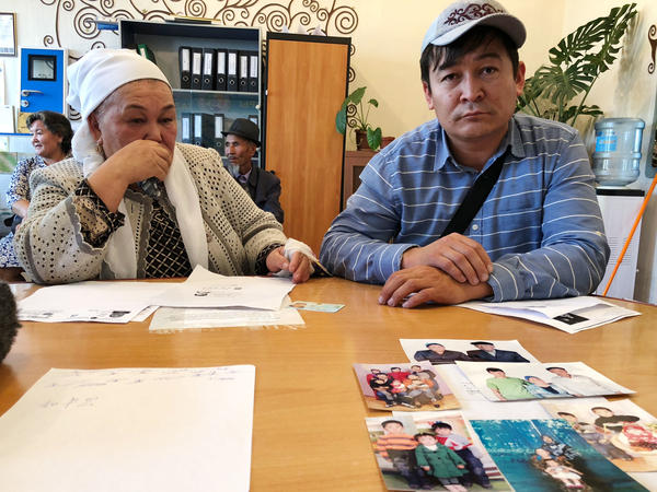 Kalida Akytkhan, pictured with her son Parkhat Rakhymbergen, has two sons and two daughter-in-laws who have been detained in re-education camps in Xinjiang. She brought photos of her family to the offices of rights organization Atazhurt in Almaty.