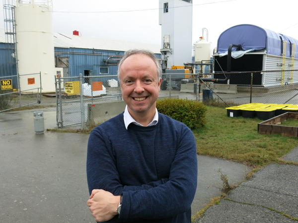 Carbon Engineering CEO Steve Oldham stands in front of the company's Squamish, British Columbia, pilot plant. It uses a chemical process to extract carbon dioxide from the air and turn it into a fuel similar to crude oil.