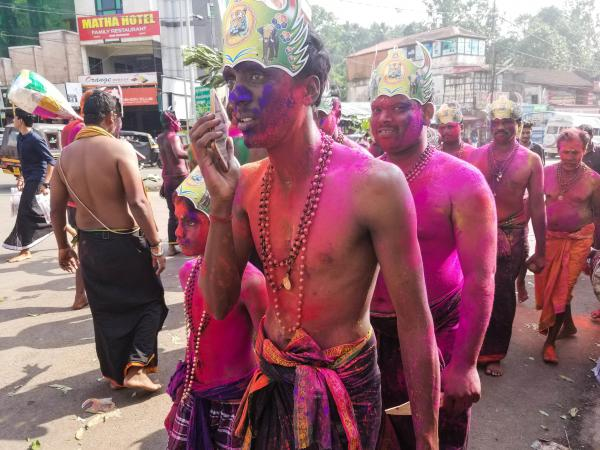 Male pilgrims with painted faces and wearing sarongs and beads walk through the streets in Erumely, on the pilgrimage route to the Sabarimala temple in southern India. Men of all ages are allowed to visit the temple, but women between the ages of 10 and 50 had been banned.