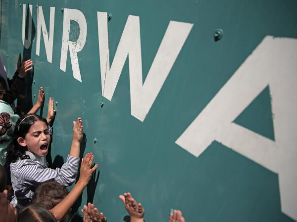 A Palestinian schoolgirl protests against a funding gap at the U.N. Relief and Works Agency in Gaza City, in 2015.