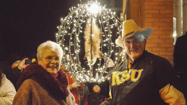Bud and Jackie Jones pose near Spencer the stuffed opossum (in his lighted countdown ball) in Tallapoosa, Ga., in 2014.