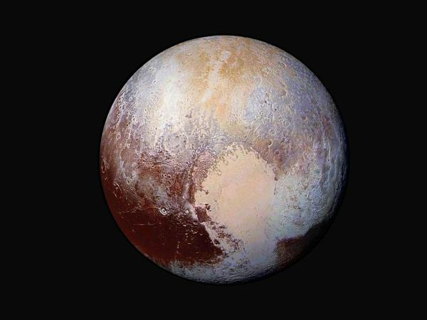 NASA's New Horizons mission flew past Pluto on July 14, 2015, revealing a world with ice mountains and an atmosphere. Four images were combined with color data to create this enhanced color global view of Pluto.
