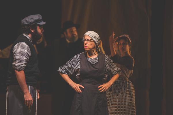 "Jackie Hoffman (right) plays Yente the matchmaker in the Yiddish adaptation of <em>Fiddler. </em>Hoffman grew up hearing her mother and grandmother speak Yiddish and for years has been teaching little phrases to fellow cast members. ""I've got gentiles speaking Yiddish all over this town now,"" she says."