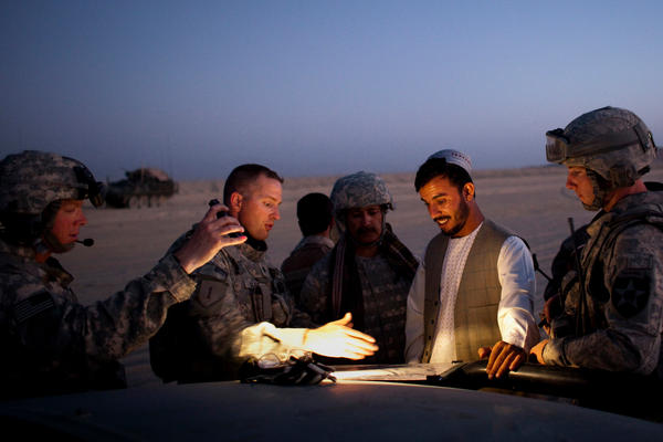U.S. Lt. Col. William Clark (second from left) talks with Brig. Gen. Abdul Raziq, then serving as the border police commander for southern Afghanistan, during a joint patrol along the border with Pakistan in 2009.