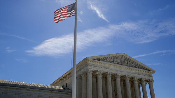 A flag flies outside the U.S. Supreme Court in Washington, D.C. The Trump administration's reshaping of the federal judiciary continued at a steady pace, with 18 new appeals court judges confirmed in 2018.