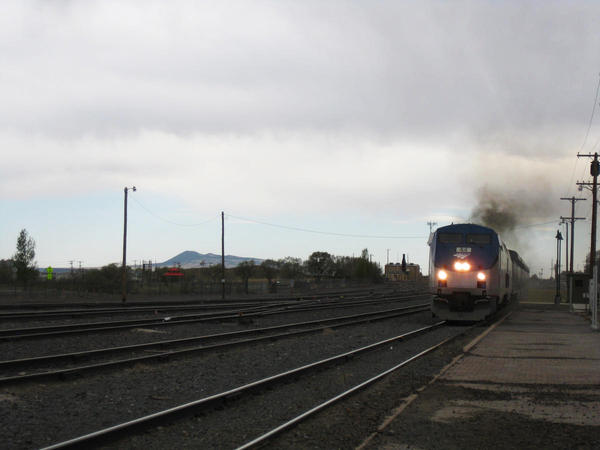 In this file photo, Amtrak's Southwest Chief pulls into the Raton, New Mexico station on an overcast day in May 2014.