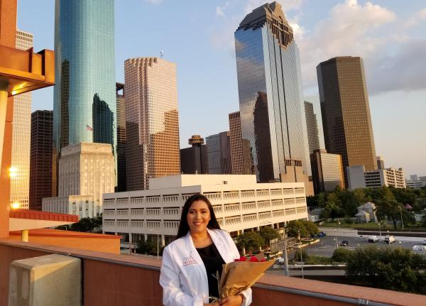 "Andrea Hernandez poses during a ""white coat"" ceremony in August to welcome her to the medical profession at UT Health in Houston."