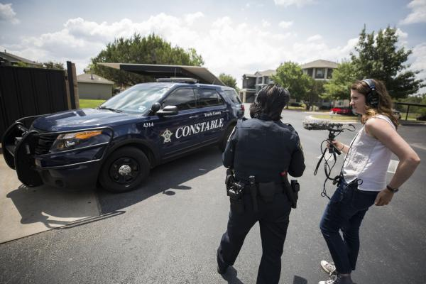 KUT's Audrey McGlinchy speaks with Travis County Deputy Theresa Stewart while reporting on evictions last summer.