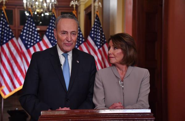 House Speaker Nancy Pelosi and Senate Democratic leader Chuck Schumer pose for pictures after delivering a response to President Trump's televised address to the nation.