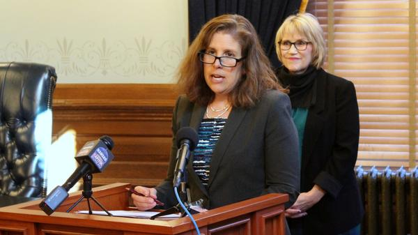 Judith Deedy speaking at the Statehouse Tuesday.
