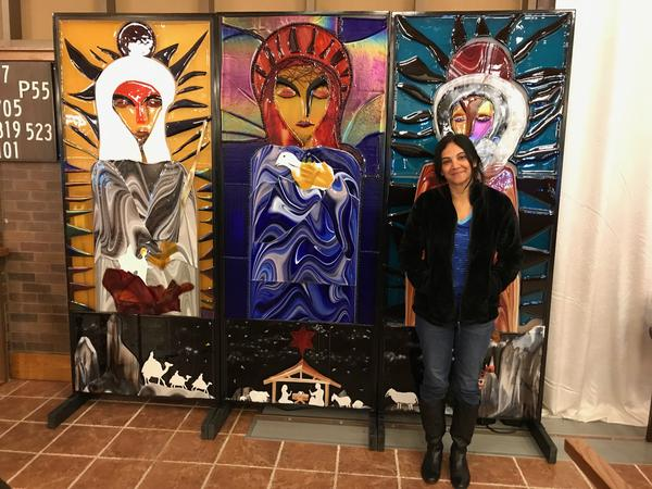 Artist Hasna Sal with her 'Nativity Triptych' at St. Catherine of Siena Catholic Church.