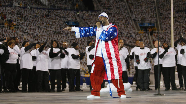 R. Kelly performs at the opening ceremony of the 2002 Winter Olympics in Salt Lake City, Utah. That very same day, Feb. 8, Chicago police revealed their investigation into allegations that the singer had filmed himself having sexual relations with an underage girl.