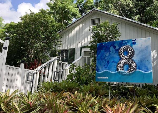 During Art Basel week, households participating in the Underwater Homeowners Association displayed signs with their homes' elevations.