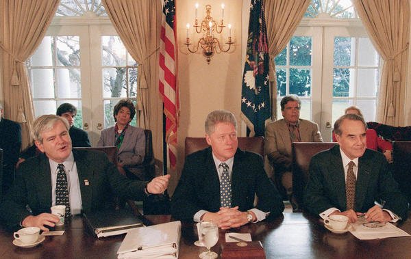 Then-House Speaker Newt Gingrich gestures toward President Bill Clinton, as then-Senate GOP leader Bob Dole sits to the right. They met to try to work through the government shutdown in late 1995 to early 1996.