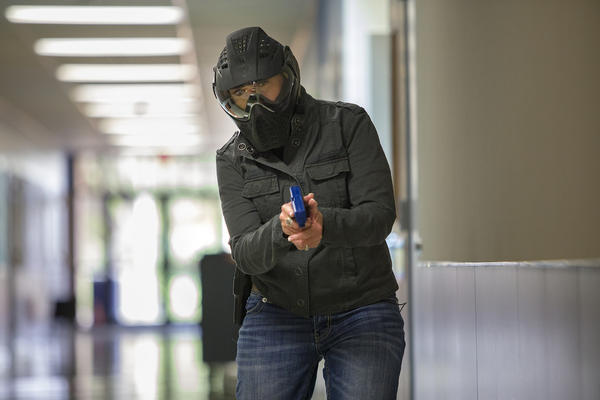A school marshal trainee goes through a simulation of an active shooting at an elementary school in Pflugerville in August.