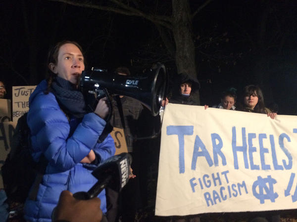 Graduate student Lindsay Ayling speaks to a couple dozens activists on Jan. 14, 2019 about outgoing Chancellor Carol Folt's decision to remove the Silent Sam pedestal from campus.