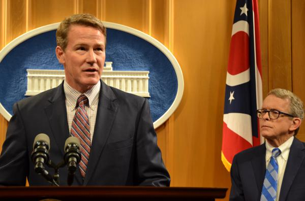 Lt. Gov.-elect Jon Husted with Gov.-elect Mike DeWine looking on.