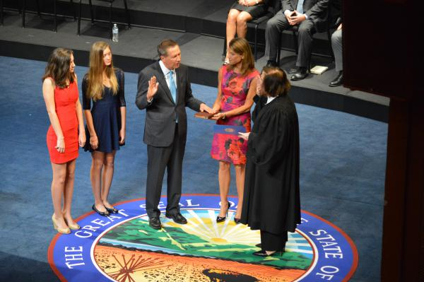 Gov. John Kasich takes the ceremonial oath of office at the Ohio Theatre in 2014 with his wife Karen and his daughters Emma and Reece looking on.