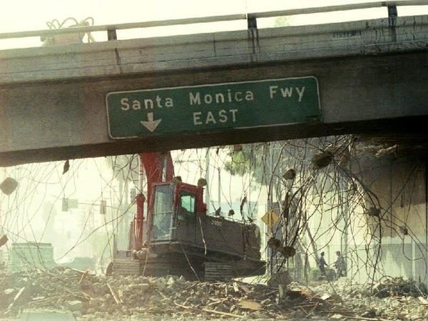 A bulldozer begins to tear down a section of the Santa Monica Freeway that collapsed during the Northridge earthquake, 25 years ago. Despite lessons learned from that earthquake, LA is far from prepared for the next big one.