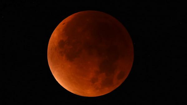 "A ""blood moon"" seen from western Germany during a total lunar eclipse on Sept. 28, 2015."